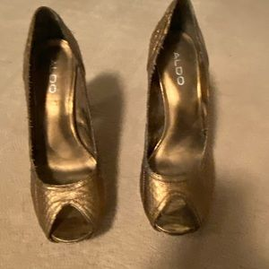Gold open toed pumps